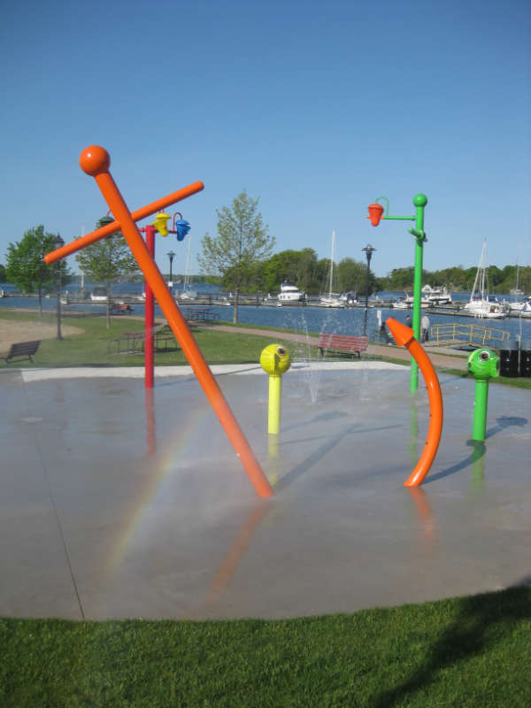 water spraying on splashpad with colourful fixtures
