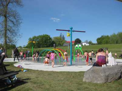 children playing on splashed in Kennedy Park, Campbelleford, Ontario