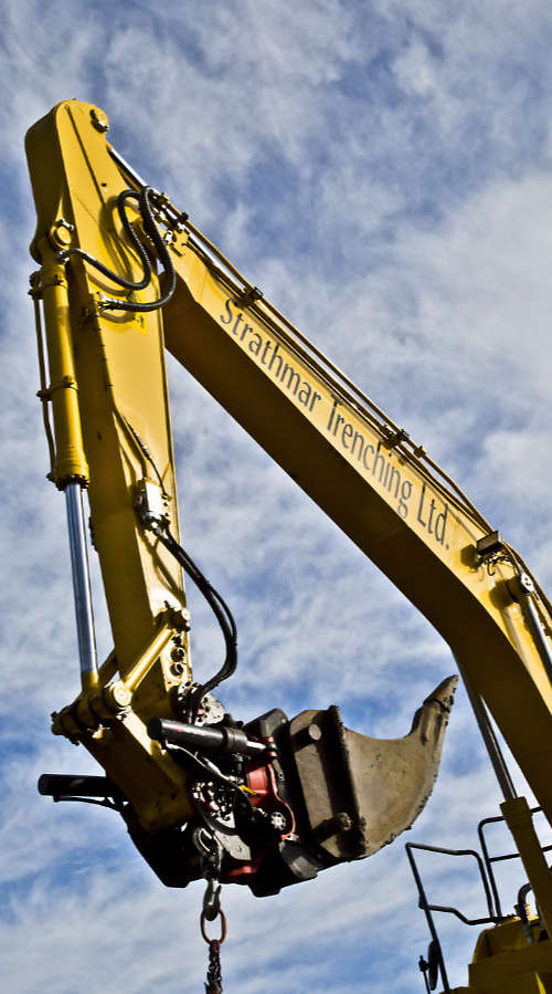 excavator arm with Strathmar logo