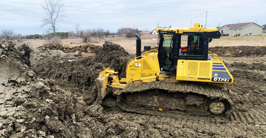bulldozer moving earth on landscape construction job site