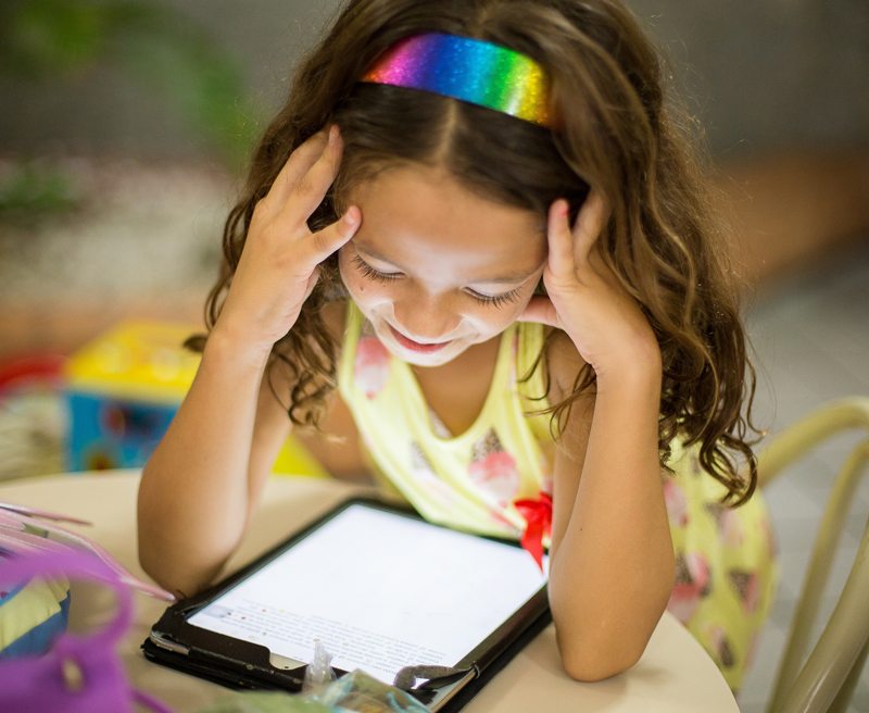 Child reading on their tablet