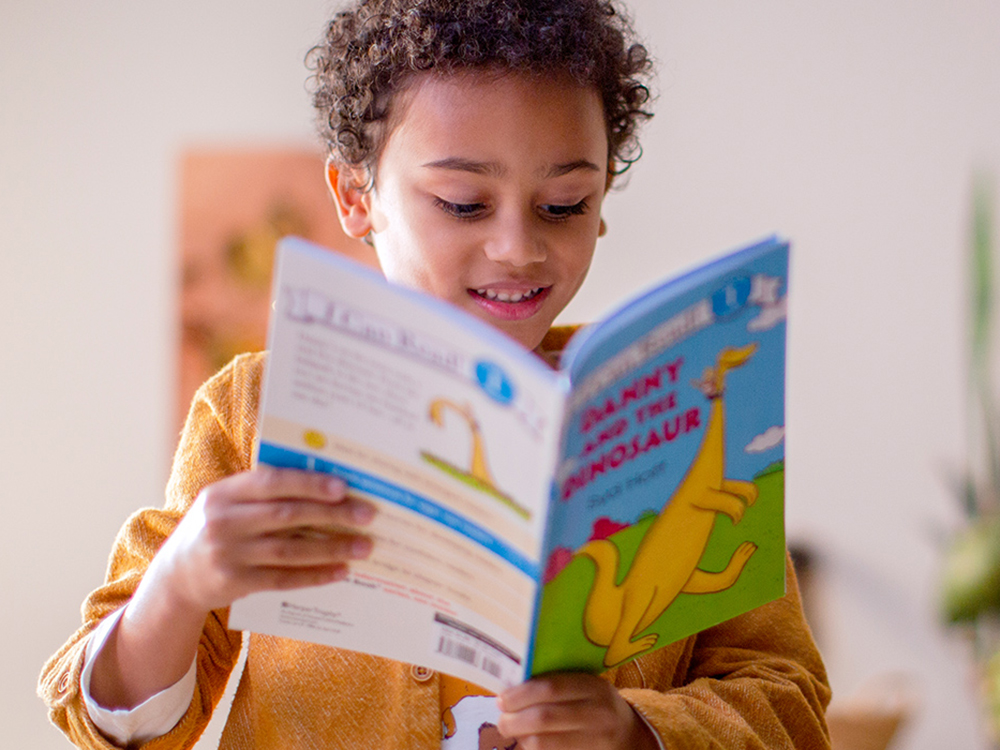 Child happily reading a book