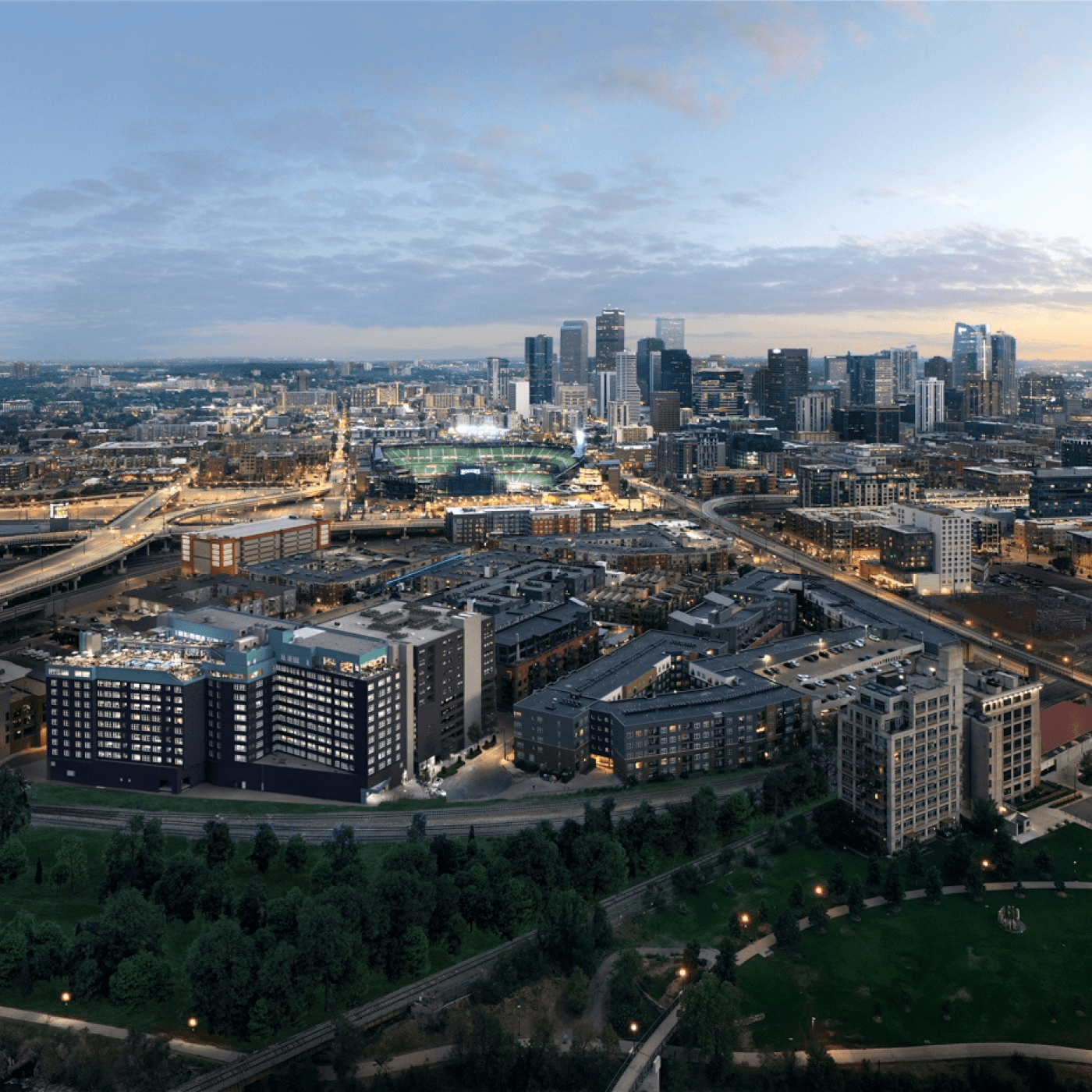 Aerial view of X Denver apartment building with Coors Field in the distance.