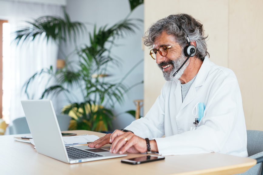 Older man sitting and working at his laptop