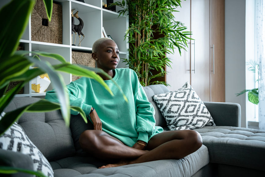 African American woman lounging on a sofa