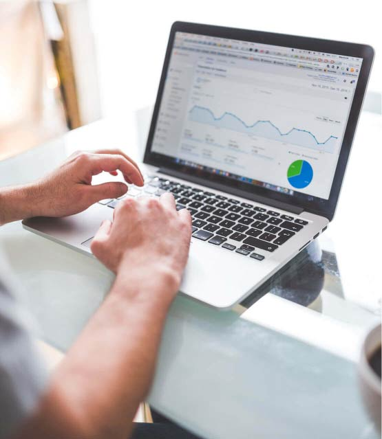 Photo of man looking at analytics on web dashboard