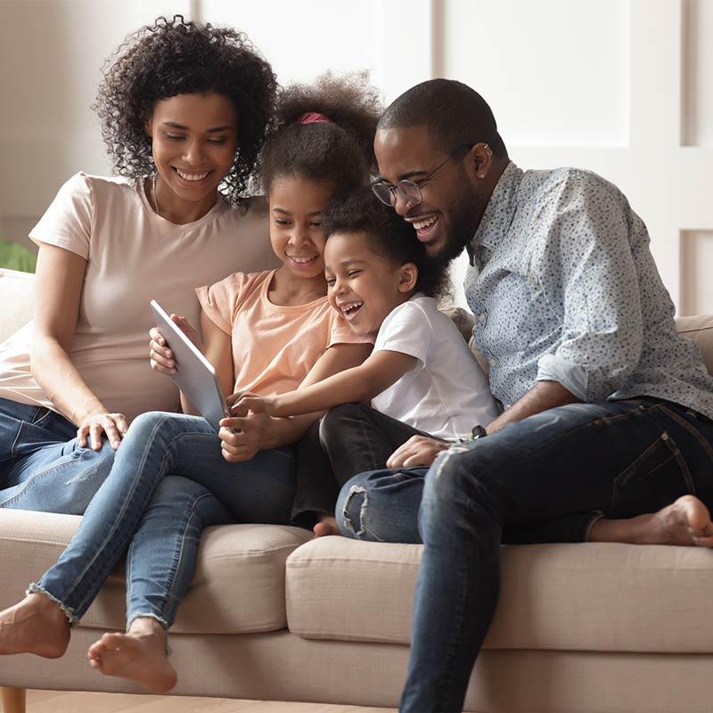 Happy family sat on sofa