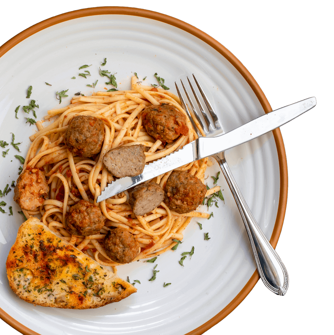 a plate of spaghetti with enhanced meatballs