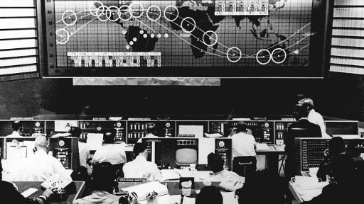 Mercury Control Center, Cape Canaveral. On the map above, the orbital path. (NASA)