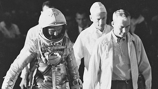 Arriving at the launchpad, February 20, 1962. At Glenn's side is Bill Douglas, the astronauts' physician; behind them is Joe Schmitt, the suit technician. (NASA)