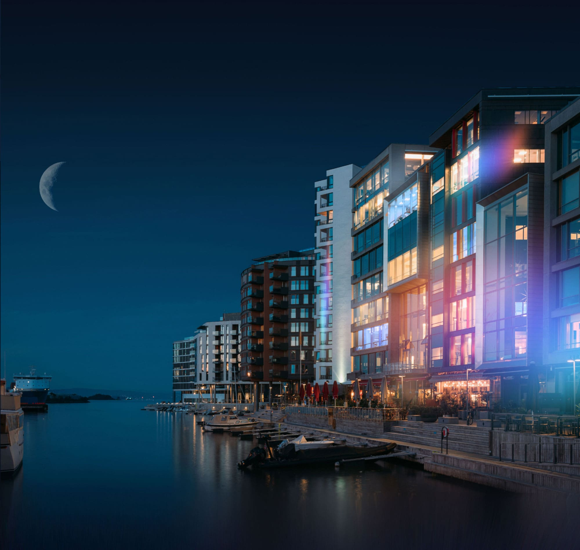 City skyline on the water with colorful lights showing different heat signatures