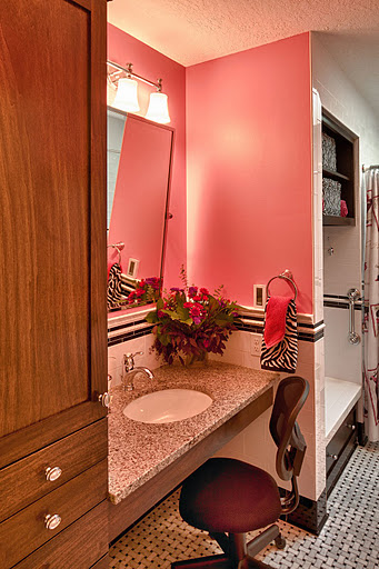 Accessible vanity that is comfortable to be used at a seated or standing position.