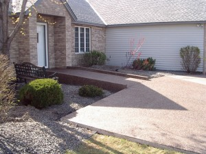 Front enterance of home installed with a patio and a gradual ramp.