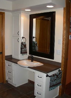 Amber's new accessible bathroom vanity that can be used while she seated in her wheelchair.