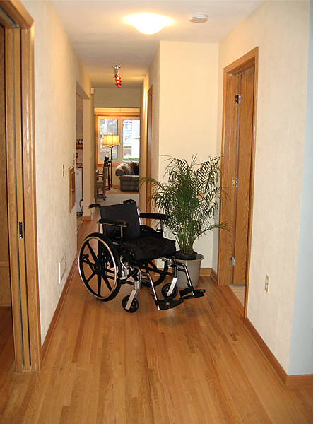 Lynn's wheelchair in his newly widen hallway.