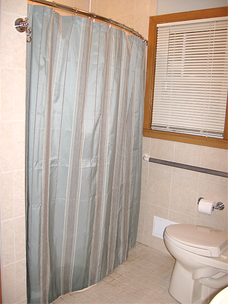 New accessible bathroom with comfort height toilet and grab bars.