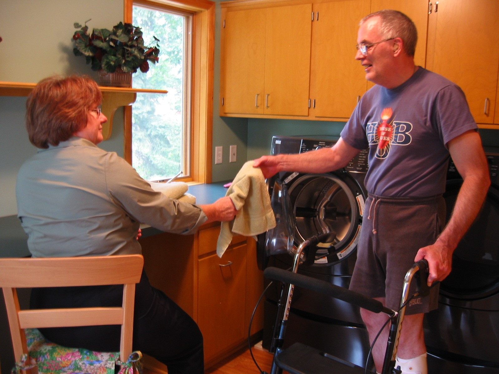 Mike and Ann doing laundry while in a seated and standing positions.