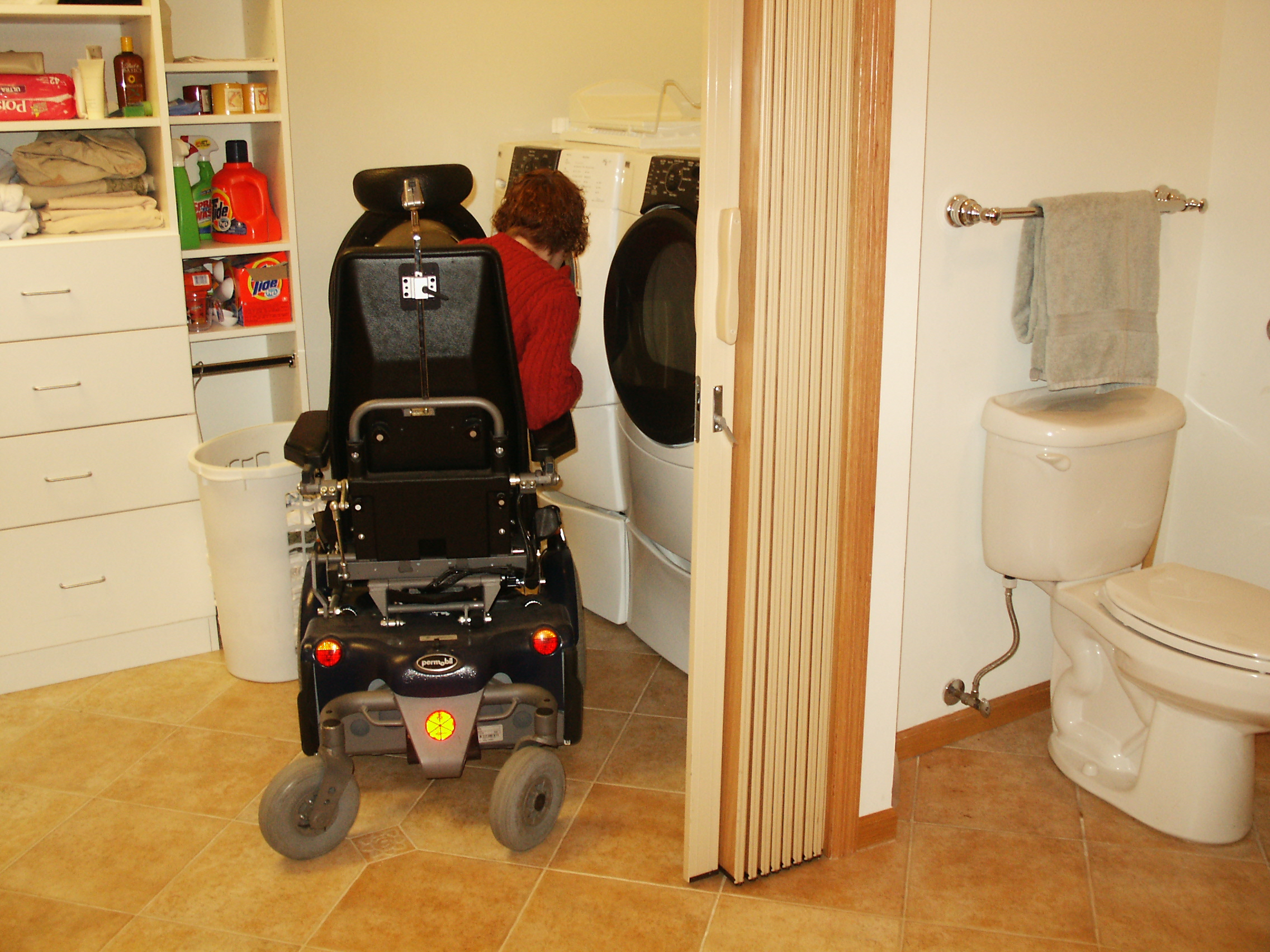 Michelle's new laundry room off her new accessible bathroom. Michelle can operate her washer and dryer while in a seated position in her wheelchair.