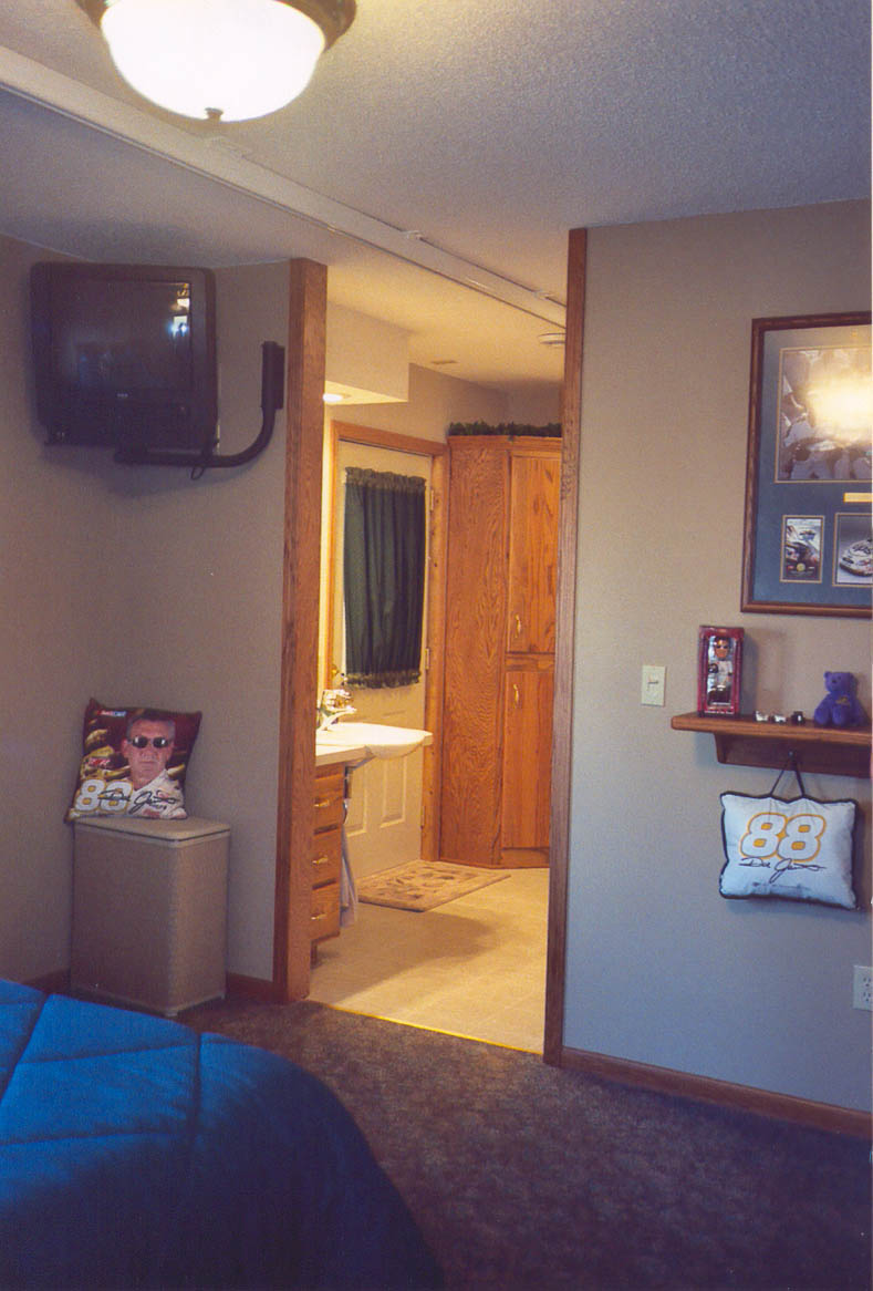 Ceiling mounted lift track from Brock's bedroom to his new accessible bathroom.