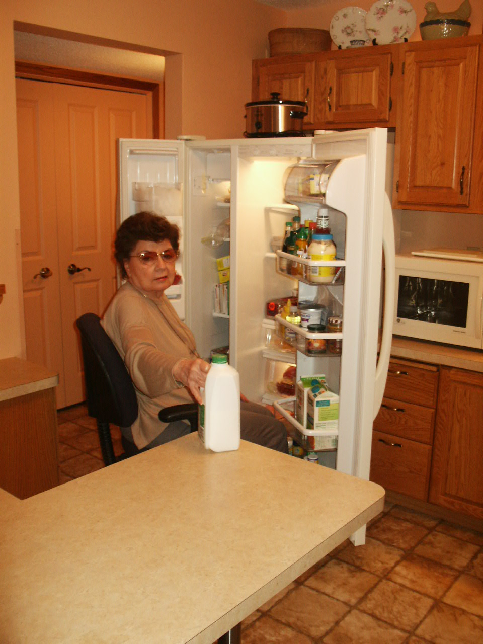 Jeanne showing how easily she can remove multiple items from her fridge.