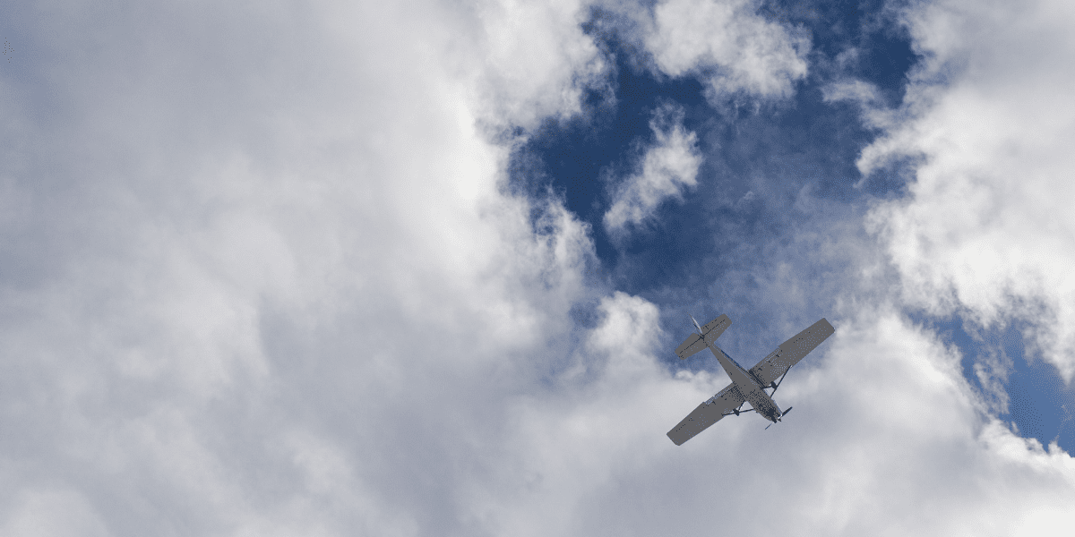 A small plane overhead against a blue sky coming into the Truckee Airport near the Martis Dam Road.
