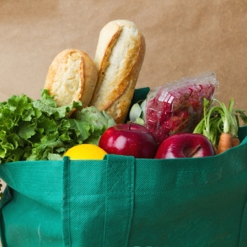 Reusable bag filled with groceries.