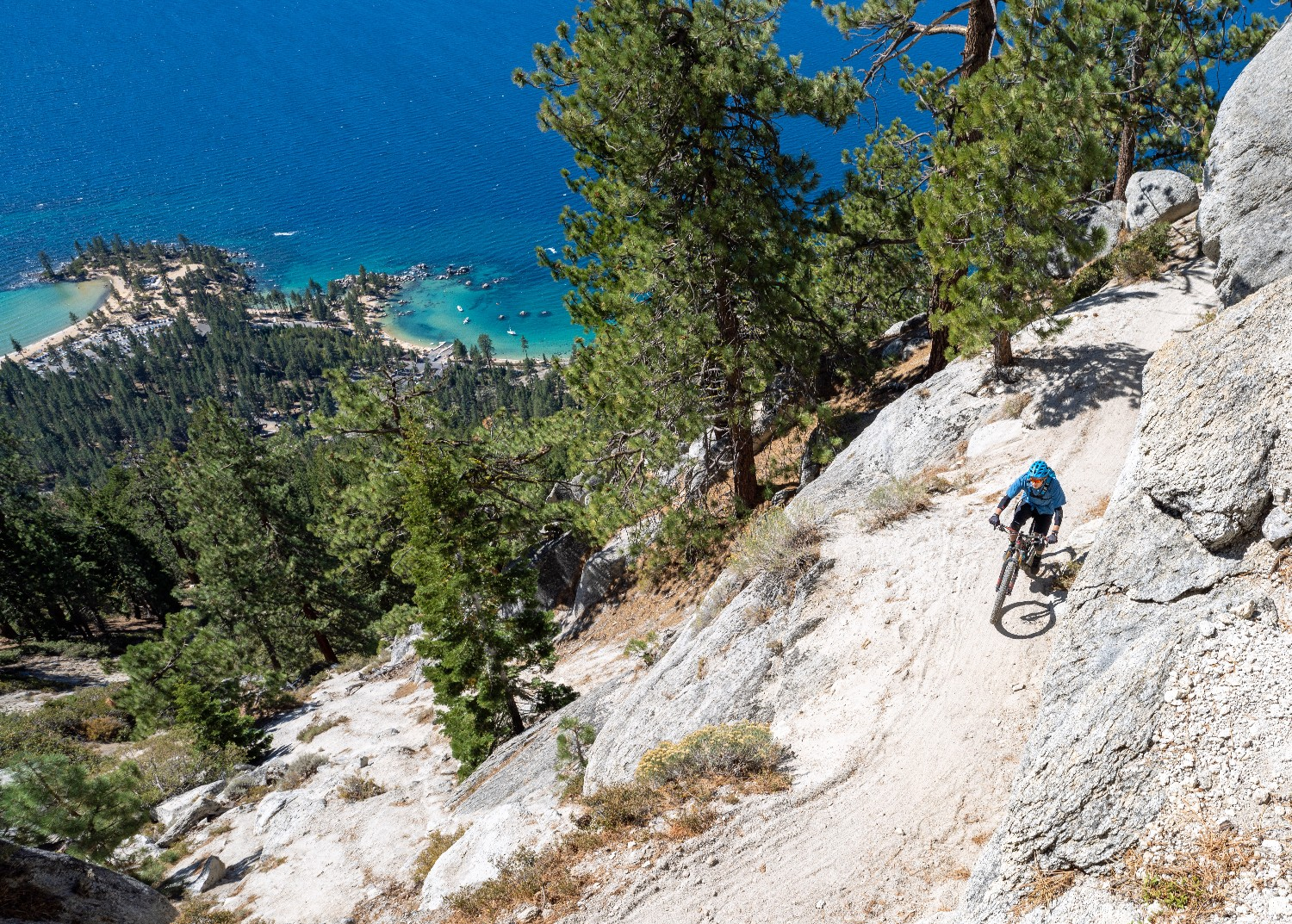 Mountain biking the Flume Trail with Lake Tahoe in background.