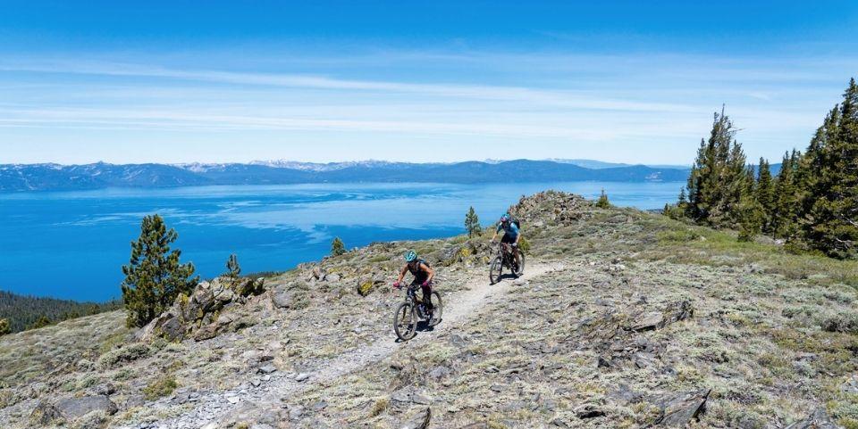 Mountain biking on a trail overlooking Lake Tahoe.