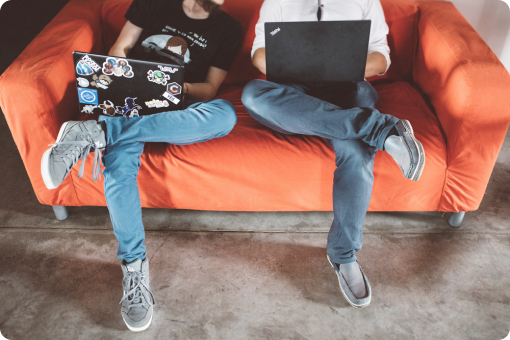 Photo of Voucherify team sitting together on the couch