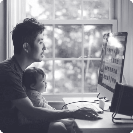 Father and son at a computer