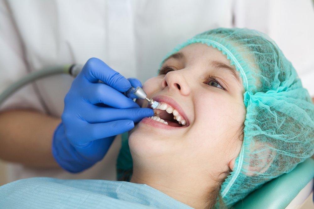child getting his teeth polished