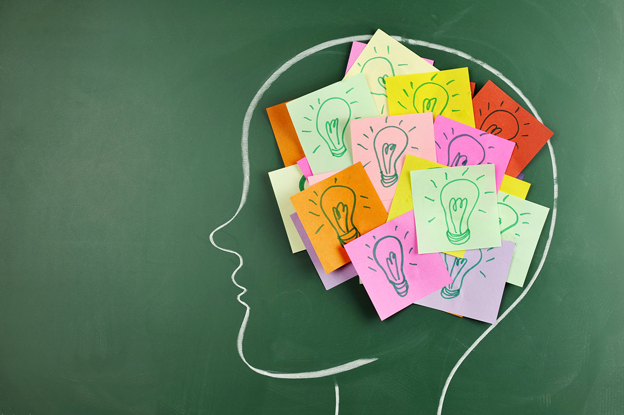 Illustration of a person with many colorful post-it notes in her brain to represent ideas