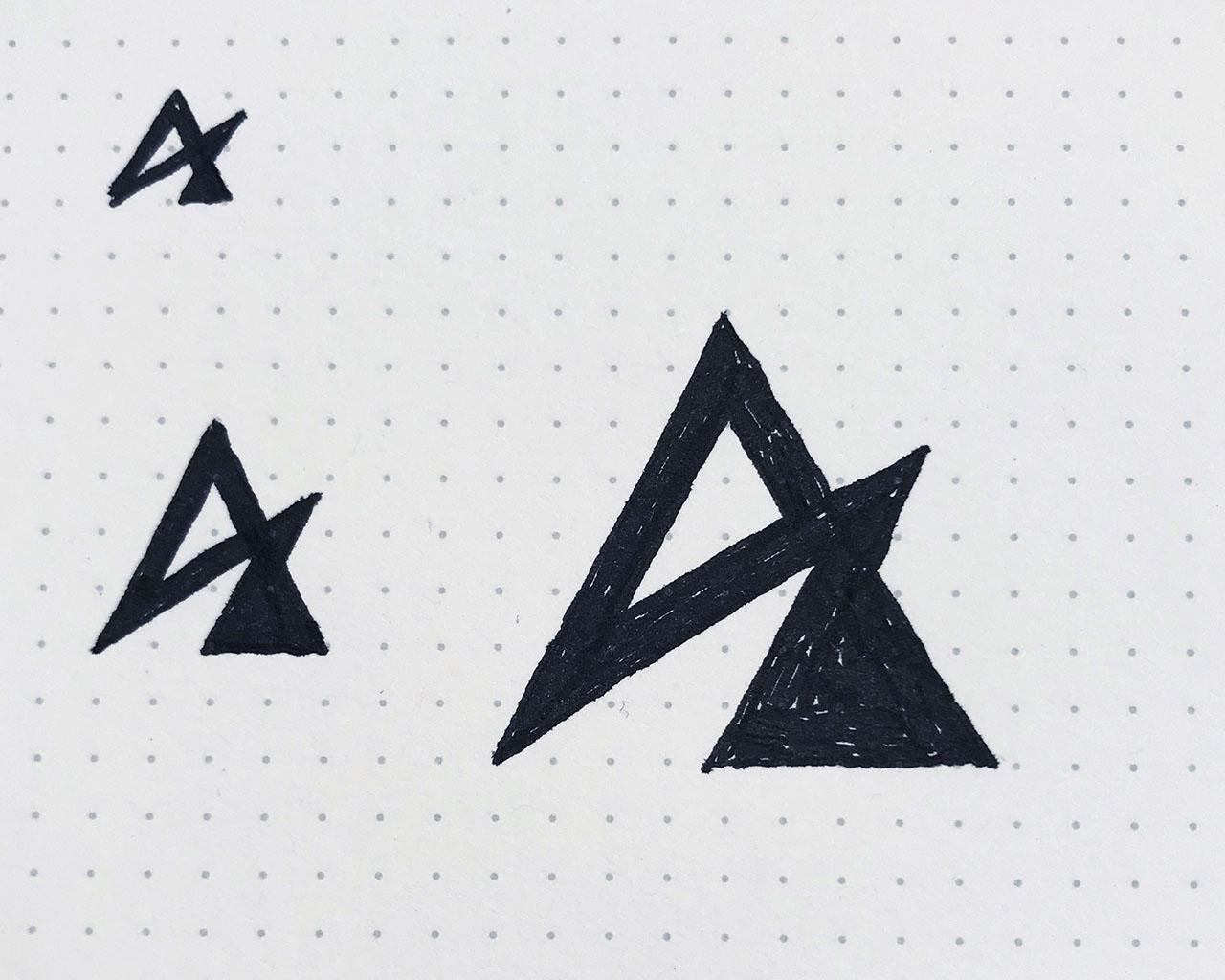 ASCEND logo sketches in sketchbook