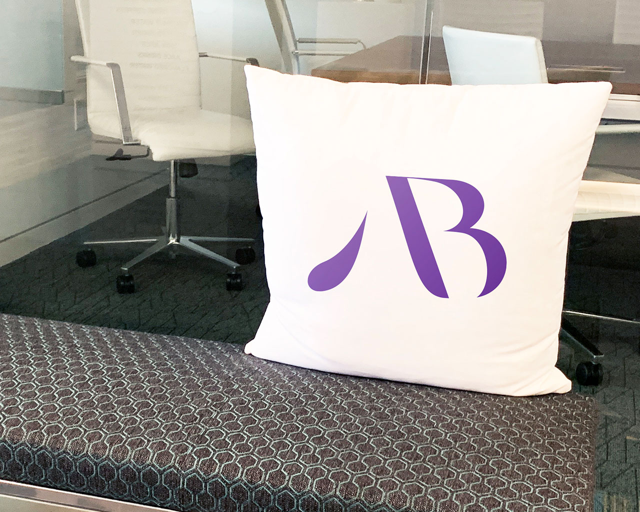 Office pillow with the American Beverage monogram