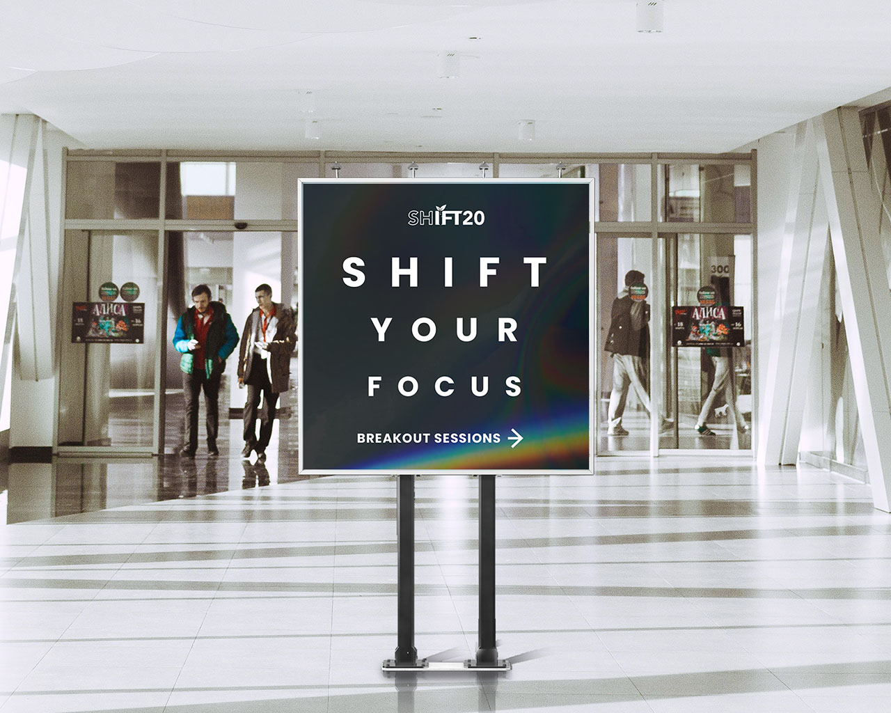 """Conference signage in a hallway that reads """"Shift Your Focus"""""""