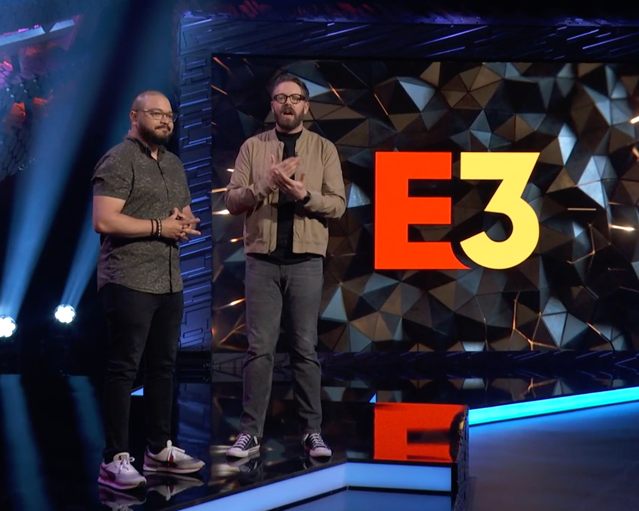 E3 2021 stage with logo on screen and hosts