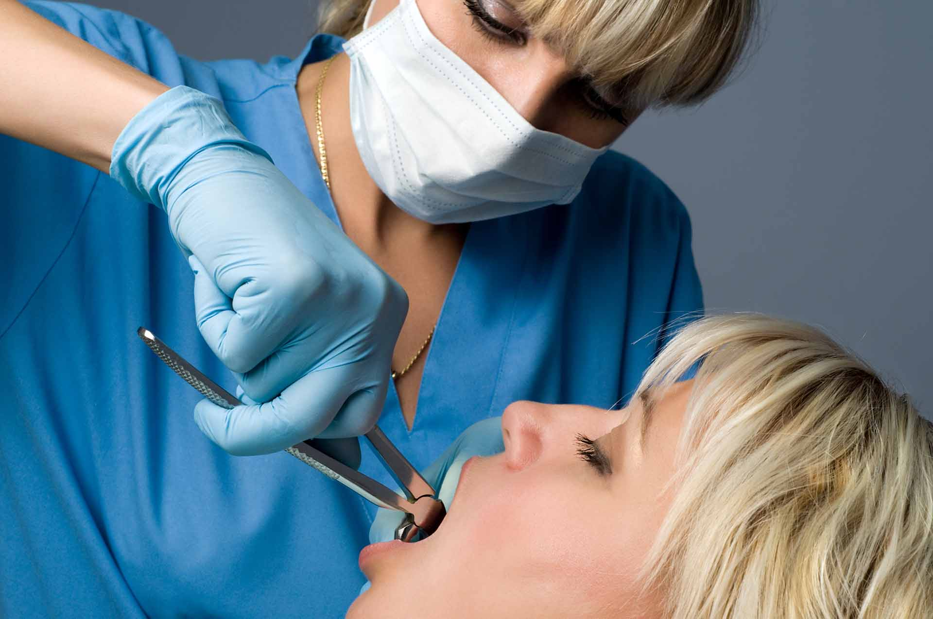 Removing an infected tooth with a tooth extraction in Franklin, NC.