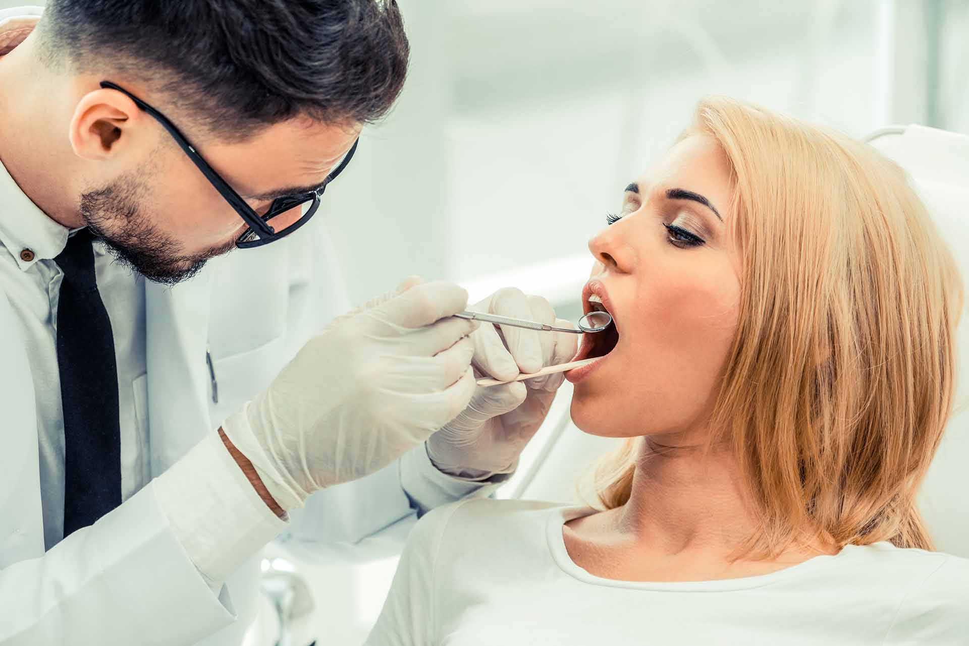 Improving your oral health with periodontal care in Candler, NC.