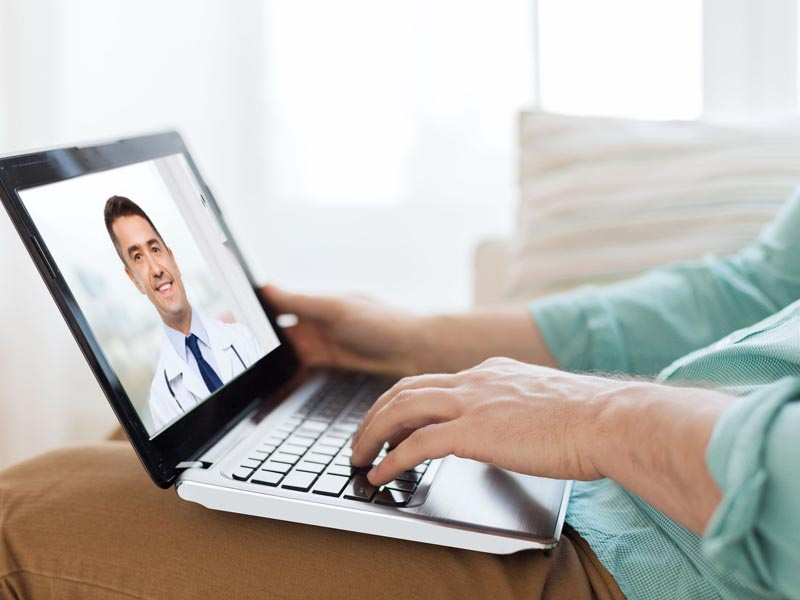 a patient talking to his doctor using telemedicine