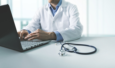 A doctor talking to a patient online