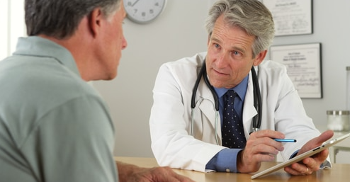 an elderly man talking to his doctor about EPAT