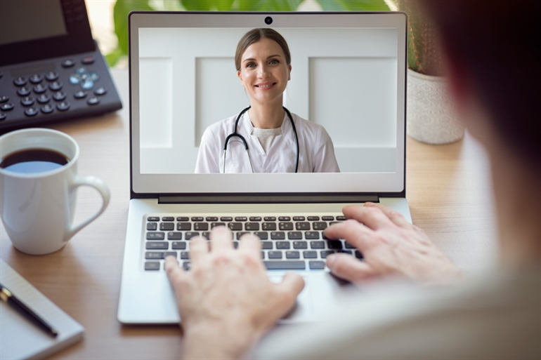 a doctor on the screen during a telemedicine session