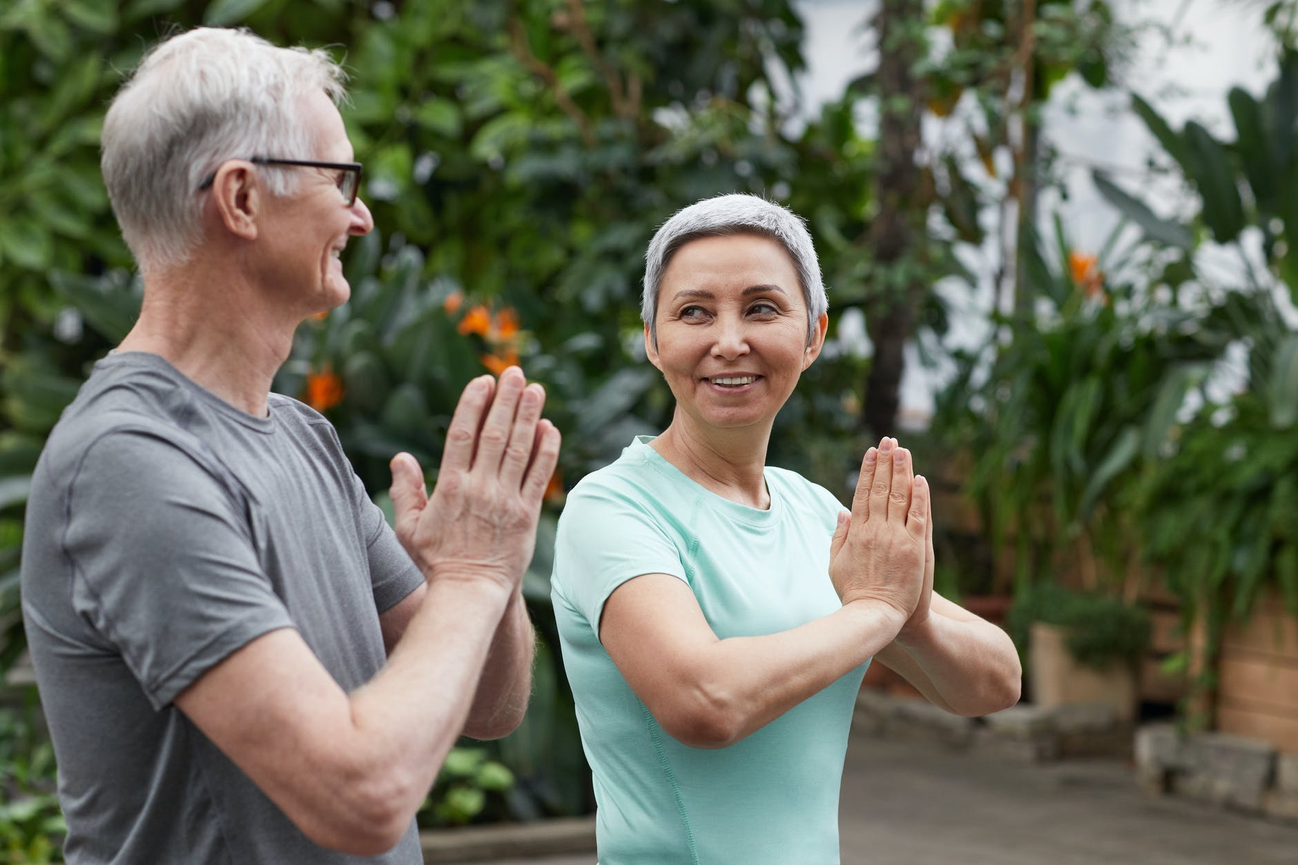 an elderly couple excercising after epat for lower back pain