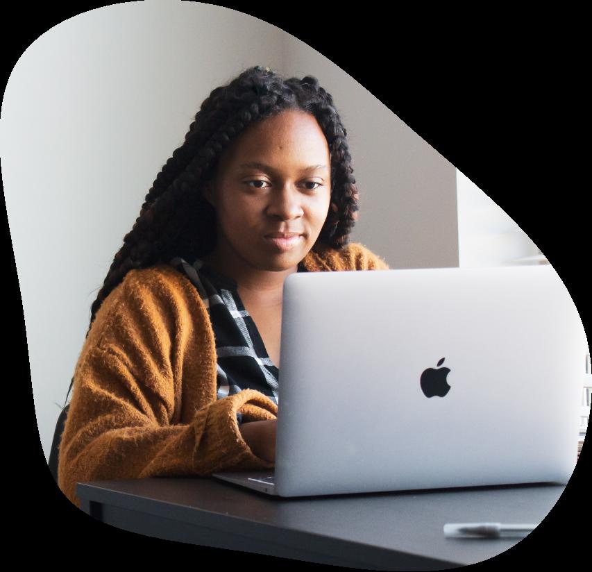 Black woman on a MacBook Pro