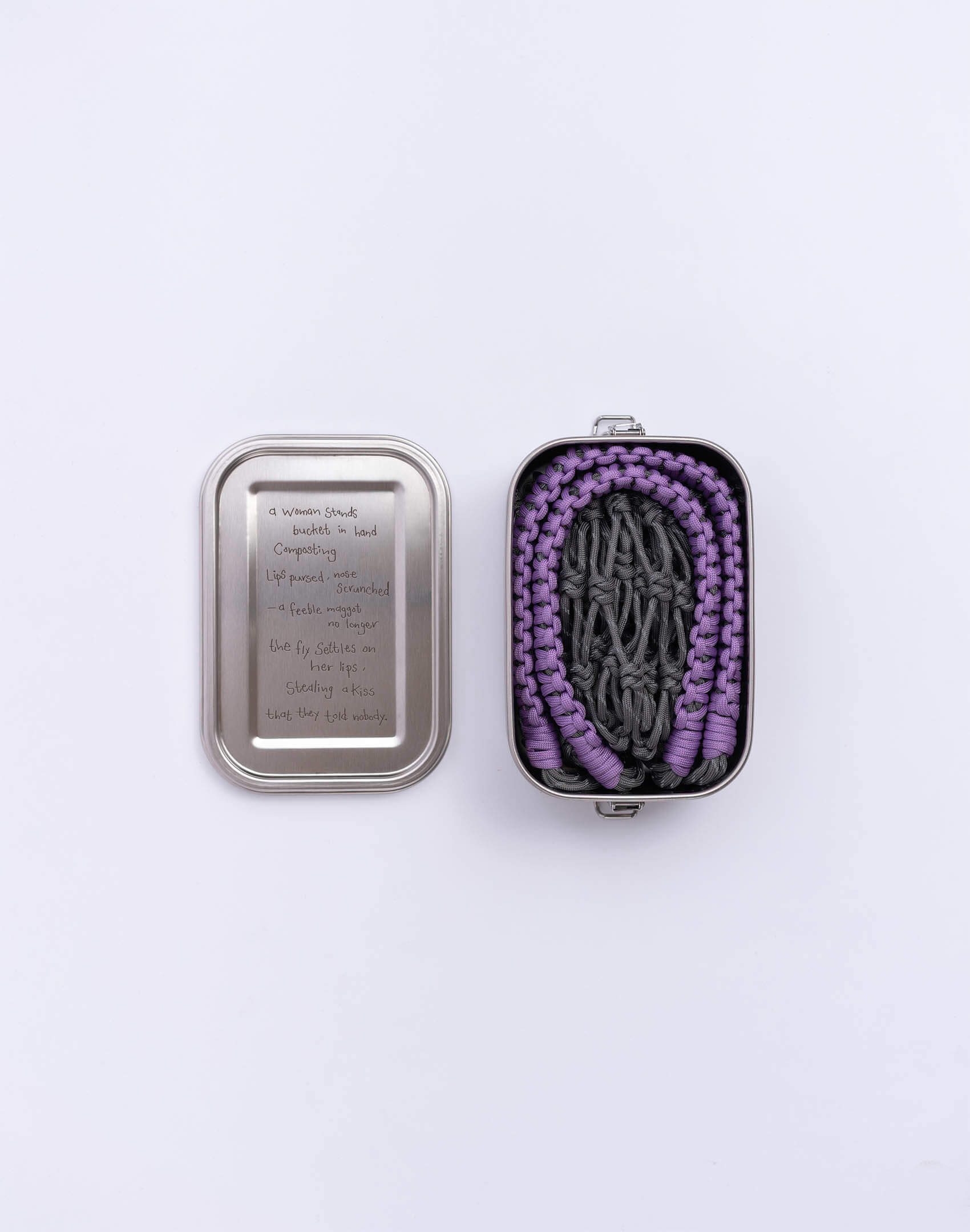 P.S. Field Bag 14 (James Baldwin), gray/lilac colorway. Stainless steel lunchbox featuring tender love poem between a woman and fly.