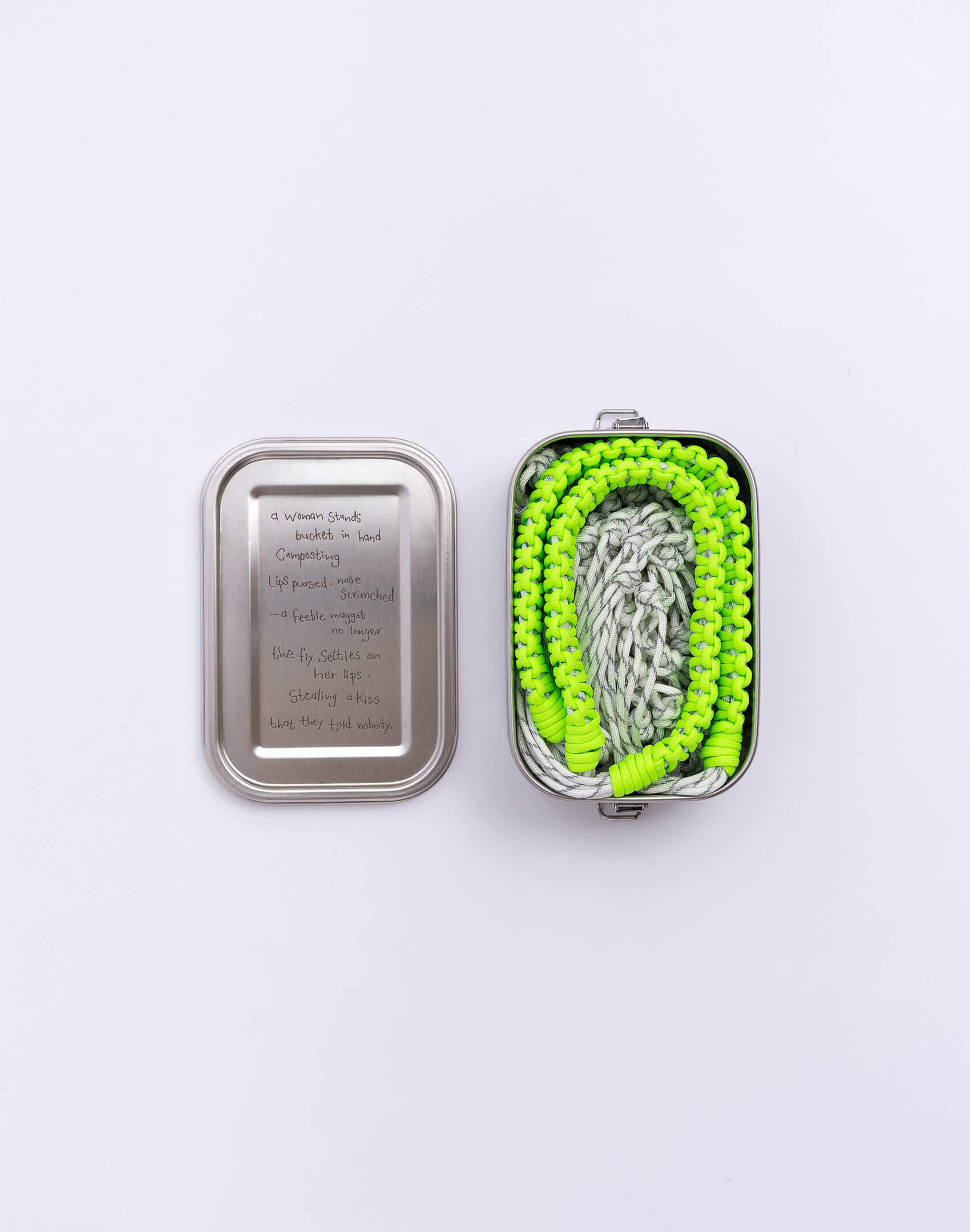P.S. Field Bag 15 (Dad Shoe), white reflective/neon green colorway. Stainless steel lunchbox featuring tender love poem between a woman and fly.