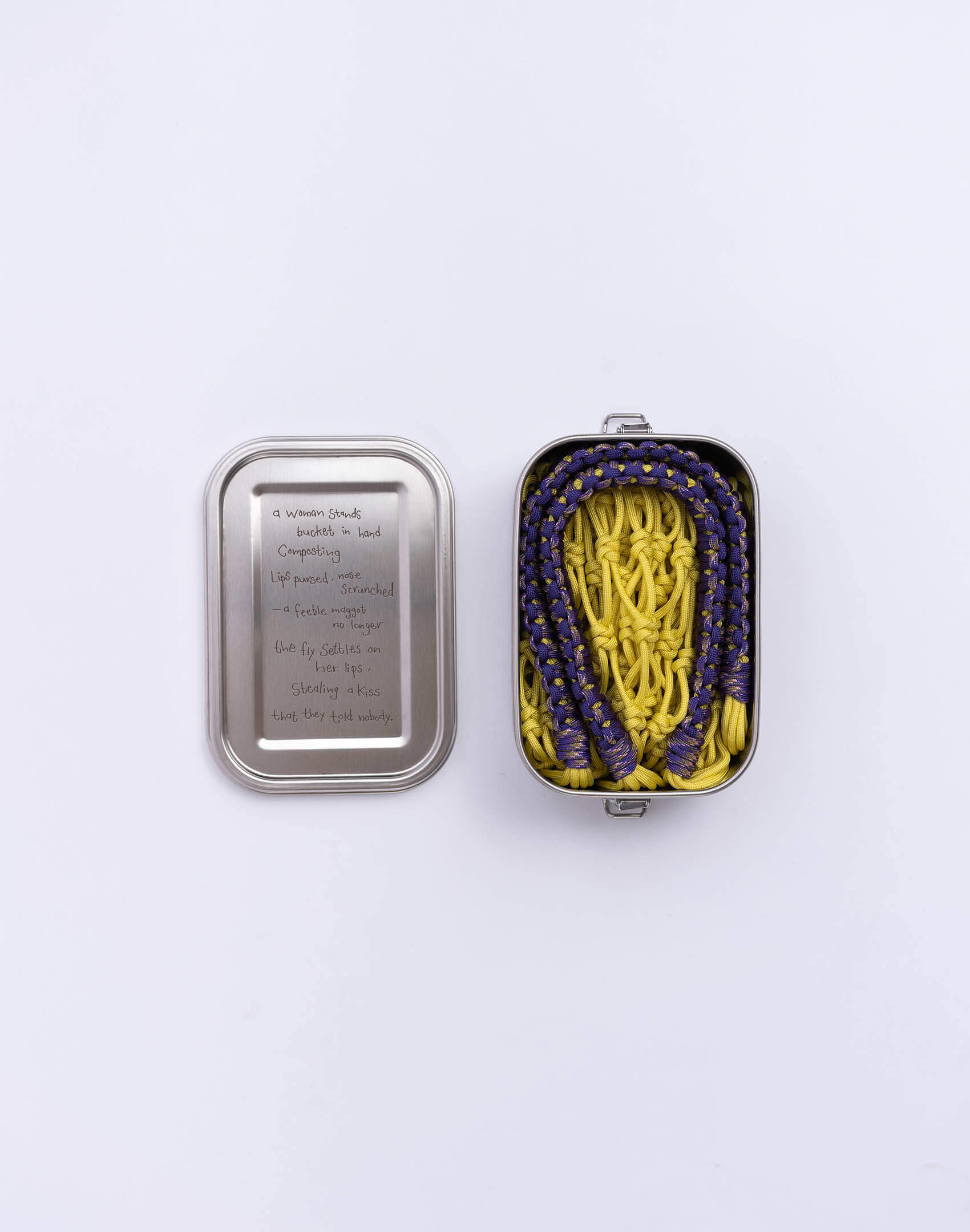 P.S. Field Bag 20 (Sakura), yellow/purple colorway. Stainless steel lunchbox featuring tender love poem between a woman and fly.