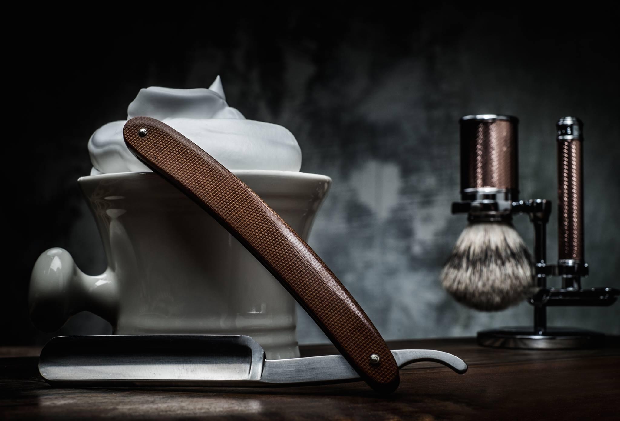 A razor, shaving foam and brush.