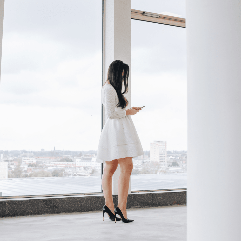 Girl standing and looking on phone