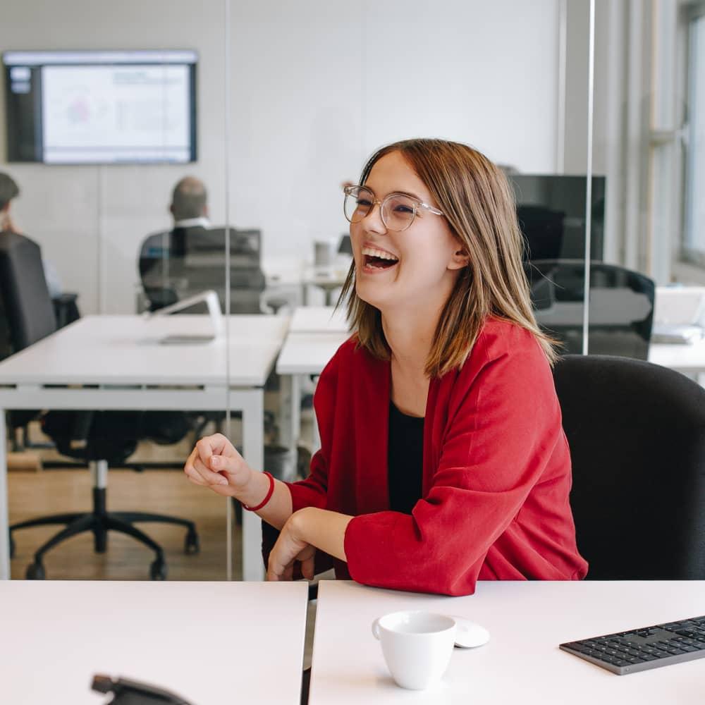 Happy person behind desk